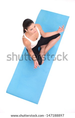 Lotus Position. Top view of beautiful young women sitting in a lotus position and meditating - stock photo