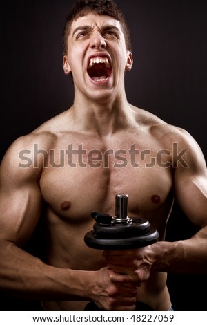 Loud scream of powerful muscular bodybuilder over black - stock photo