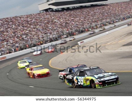 LOUDON, NH - JUNE 27: Carl Edwards races off turn one for the LENOX Tools 301 race at the New Hampshire Motor Speedway in Loudon, NH on June 27, 2010 - stock photo