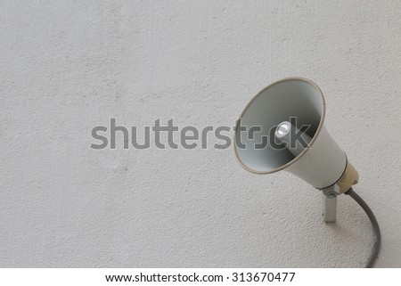 loudspeaker setting on the wall for present News in public place - stock photo