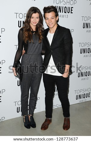 Louis Tomlindson (One Direction) and girlfriend Eleanor Calder arrives at the Unique show as part of London Fashion Week AW13, Tate Modern, London. 17/02/2013 Picture by: Steve Vas - stock photo