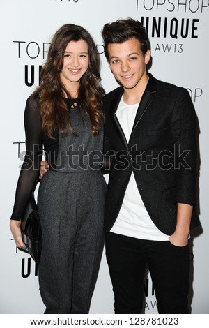 Louis Tomlinson (One Direction) and girlfriend Eleanor Calder arrives at the Unique show as part of London Fashion Week AW13, Tate Modern, London. 17/02/2013 Picture by: Steve Vas - stock photo