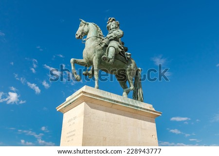Louis XIV Sculpture in Versailles palace, France - stock photo