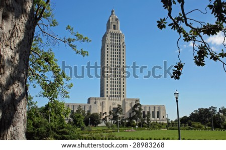 Louisiana State Capital building viewed through trees. Tallest state capital in the USA. - stock photo