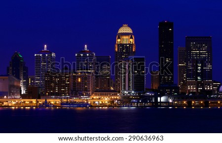 Louisville, Kentucky skyline at night, as seen from across the Ohio River - stock photo