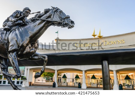 LOUISVILLE, KENTUCKY, USA - MAY 15, 2016:   Entrance to Churchill Downs featuring a statue of 2006 Kentucky Derby Champion Barbaro. - stock photo