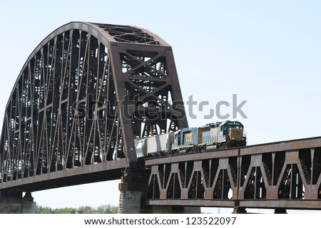 LOUISVILLE, KY - NOVEMBER 10: A Canadian National train crosses over a steel truss bridge over the Ohio River on November 10, 2012 in Louisville, Kentucky. - stock photo