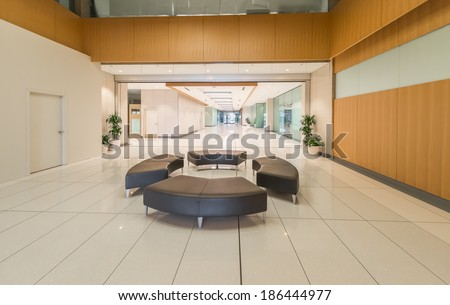 Lounge area. Modern lobby, hallway  of the five stars luxury hotel, business center in Vancouver, Canada. Interior design. Vertical. - stock photo