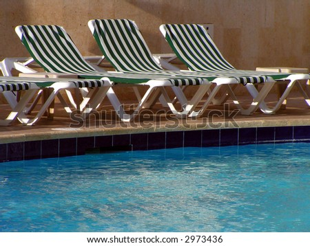 Lounge Chairs beside the Pool - stock photo