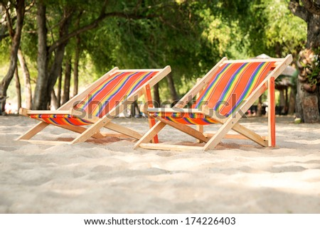 Lounge chairs for relaxing on the beach - stock photo