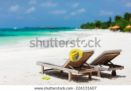 Lounge chairs on a beautiful tropical beach at Maldives - stock photo