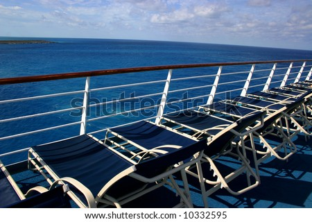 Lounge chairs on deck of cruise ship - stock photo