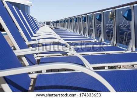 Lounge chairs on deck of luxury cruise ship - stock photo