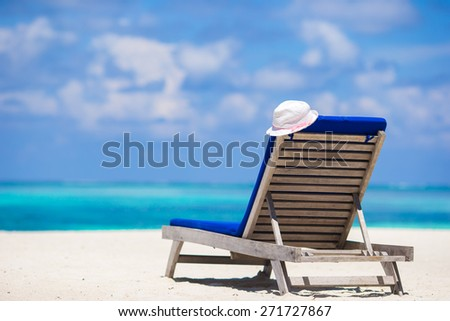 Lounge chairs with hat on tropical beach at Maldives - stock photo