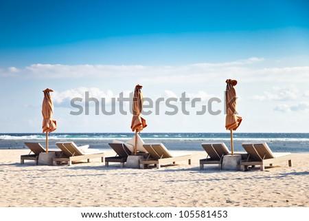 lounge on tropical beach - stock photo