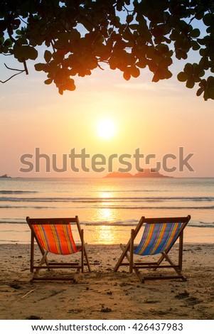 Loungers on the Sea beach at amazing sunrise. - stock photo