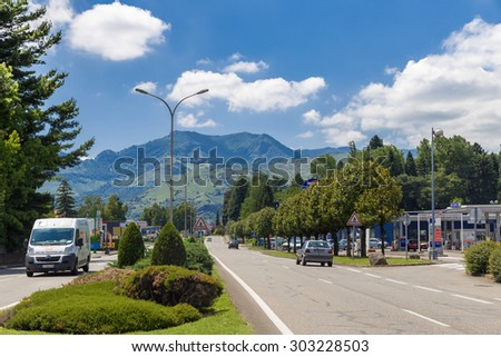 LOURDES, FRANCE - JULY 23, 2014: Avenue Francois Abadie leading into Lourdes.  Lourdes is famous for the Marian apparitions of Our Lady of Lourdes said to have occurred in 1858 to Bernadette Soubirous - stock photo