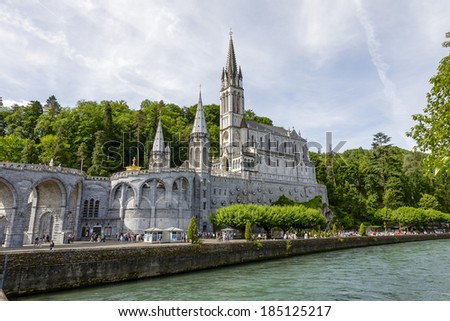 LOURDES, FRANCE - JUNE 06, 2012: The Basilica of our Lady of the Rosary, designed by architect Leopold Hardy, completed in 1899, consecrated in 1901, of a capacity of 1500 worshipers - stock photo