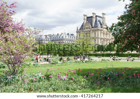 Louvre palace and Tuileries garden summer day view in Paris, France. Spring gardens in front of Louvre palace, Paris. Louvre palace view at sunny day in Paris, France. Paris landmarks. Paris travel. - stock photo