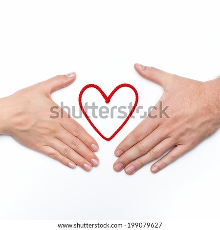 love and confidence photo with man and woman hands with red heart between - stock photo