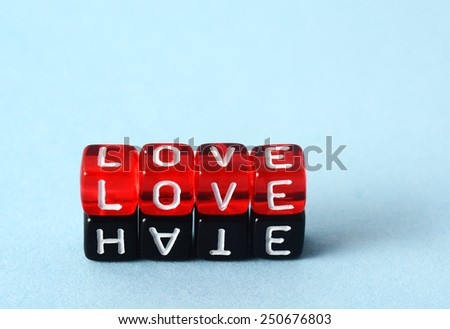Love and Hate text concept  on red and black dices - stock photo