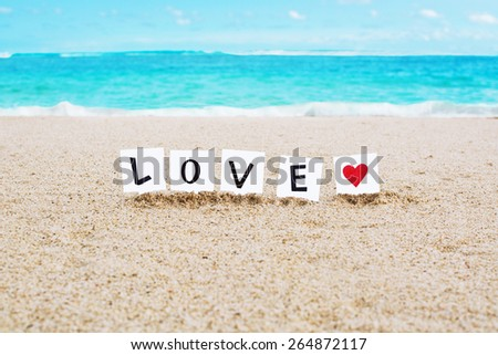 Love and heart drawing on the beach sand - stock photo