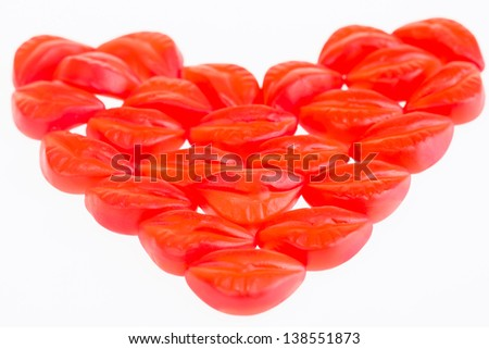 Love and kisses close up.  Red lip gummy candies in love shape. - stock photo