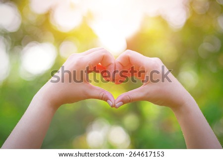 love and relationships concept closeup of hands showing heart shape - stock photo