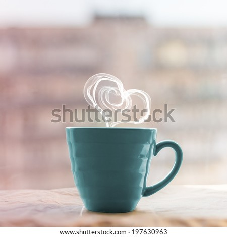 love and tea. heart silhouette from steaming hot cup  - stock photo