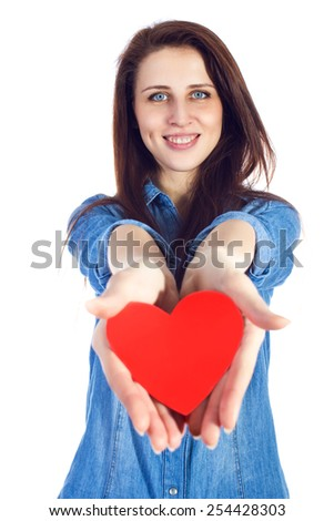 Love and Valentine's Day brunette woman with cute dimples, holding a heart in hands smiling and adorable, isolated on white background - stock photo