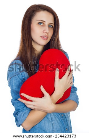 Love and Valentine's Day brunette woman with dimples, holding a heart cute and adorable isolated on white background - stock photo
