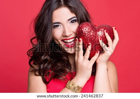 Love and valentines day woman holding red heart - stock photo
