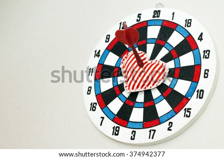 Love as aim on dartboard. Concept image, on gray backdrop - stock photo