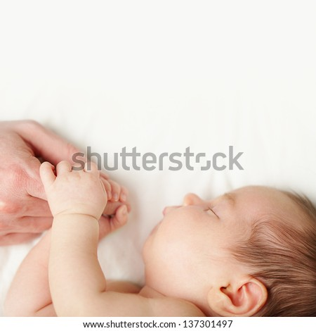 Love - baby holding fathers hand, white background - stock photo