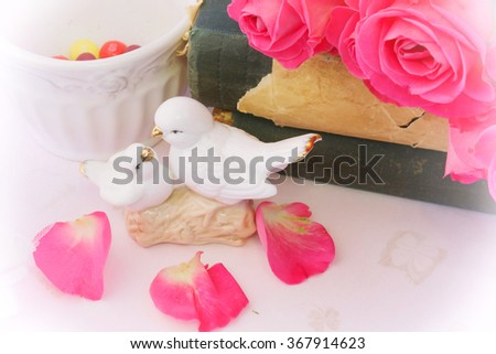 Love background in retro style figurines kissing doves rose vintage book Valentine's Day wedding Shabby Chic - stock photo