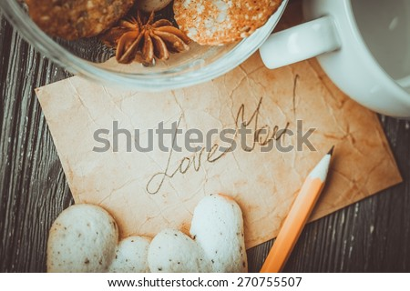 Love. Card with Message Love You on the Letter and Chocolate Cookies Shape of Heart at Valentine's Day - stock photo