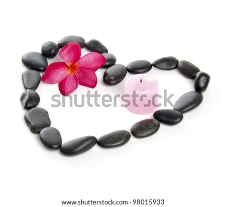Love concept decorated by stones, candle and red fragipani flower. - stock photo