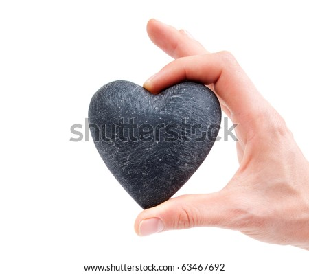 Love concept - female hand holding heart - - stock photo