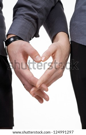 Love concept for valentines day: heart made of human hands - stock photo