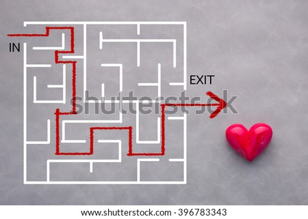 love concept maze drawing with red heart on leather background - stock photo