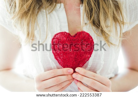 love concept, woman holding heart - stock photo
