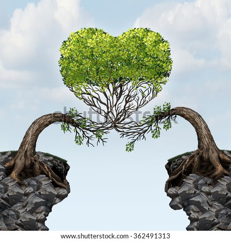 Love connection concept as two trees on divided cliffs merging together as a married couple or dating shaped as a valentine heart as a romance metaphor for overcoming obstacles in a relationship. - stock photo