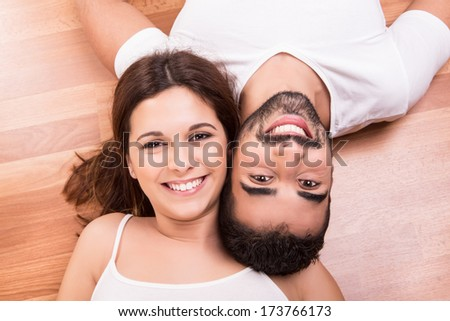 Love Couple at home relaxing on the floor - stock photo