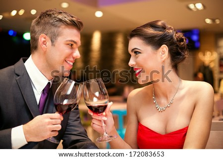 Love couple looking each other and toasting - stock photo