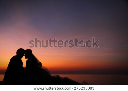 Love couple romantic scene silhouette at twilight, with copy space. - stock photo
