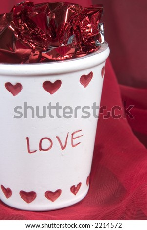 Love Cup Filled With Candy - stock photo