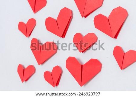 Love day. Handmade DIY origami hearts background - stock photo