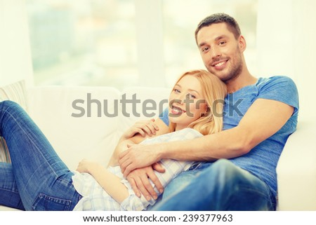 love, family and happiness concept - smiling happy couple at home - stock photo