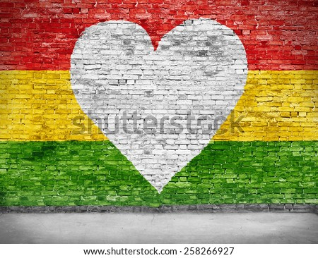 Love for reggae music loving painted over white brick wall - stock photo