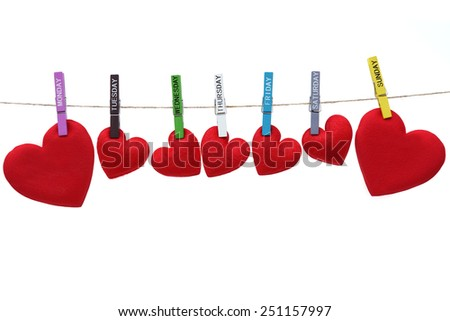 Love for Valentine's day - Red hearts hung together on the rope with wooden clips with days label on  isolated background - Love you everyday concept  - stock photo